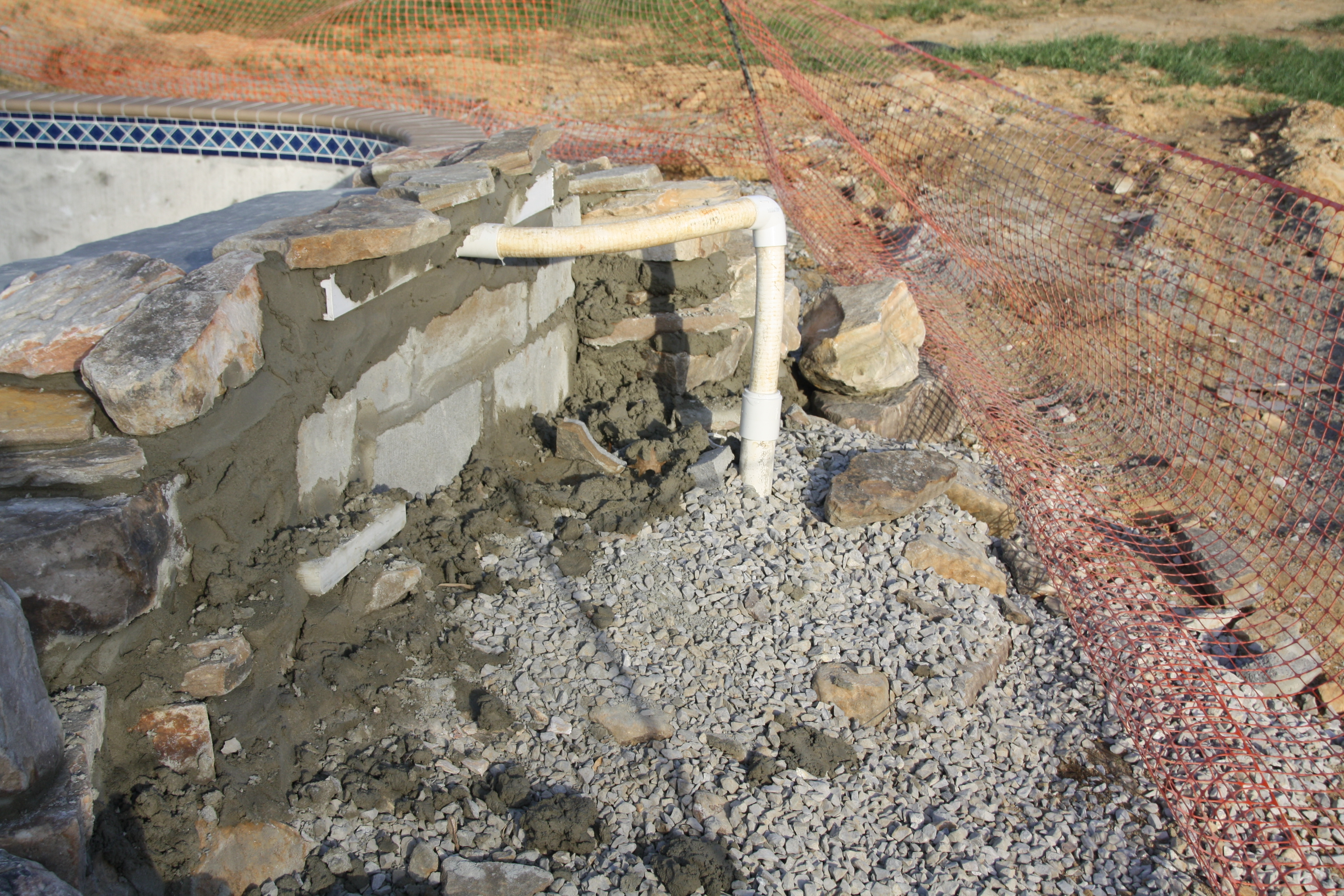 Pool waterfall problemcustom pool builder questions - How to build a swimming pool waterfall ...